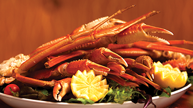 crab legs on a plate with garnish