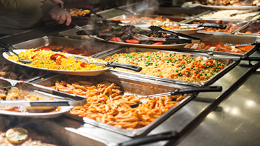 buffet trays with noodles and fried rice