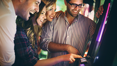 group of people playing slot machine